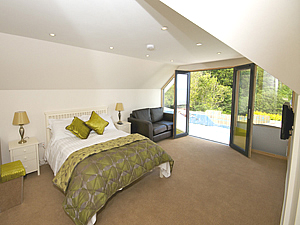 First floor master bedroom with juliet balcony and en-suite shower room