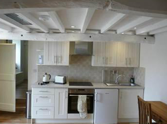 Kitchen area of open plan cottage