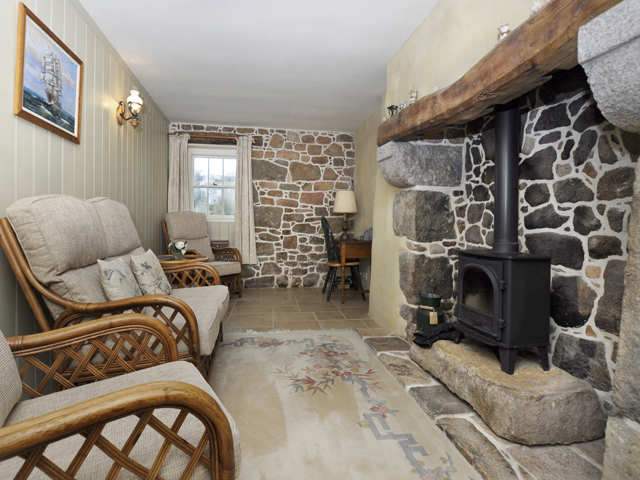 Small snug with wood burning stove