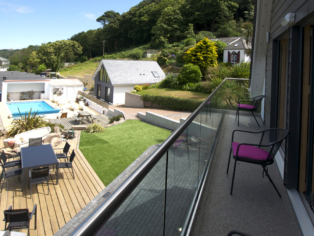 Balcony on first floor overlooks the garden and shared outdoor pool