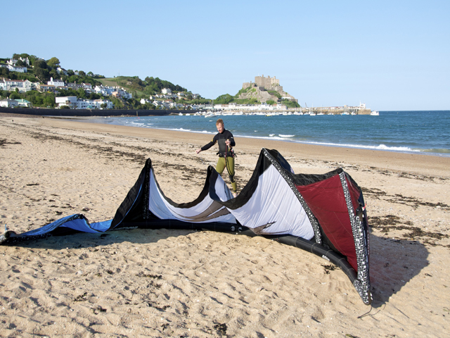 Kite surfer on the beach at Gorey, Jersey