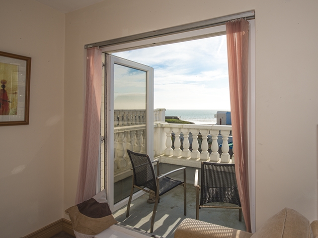 The balcony overlooks the sea on the south coast
