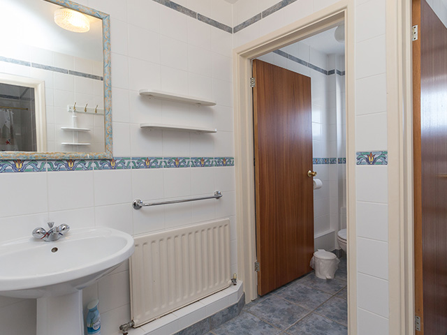 Bathroom with shower, toilet and basin