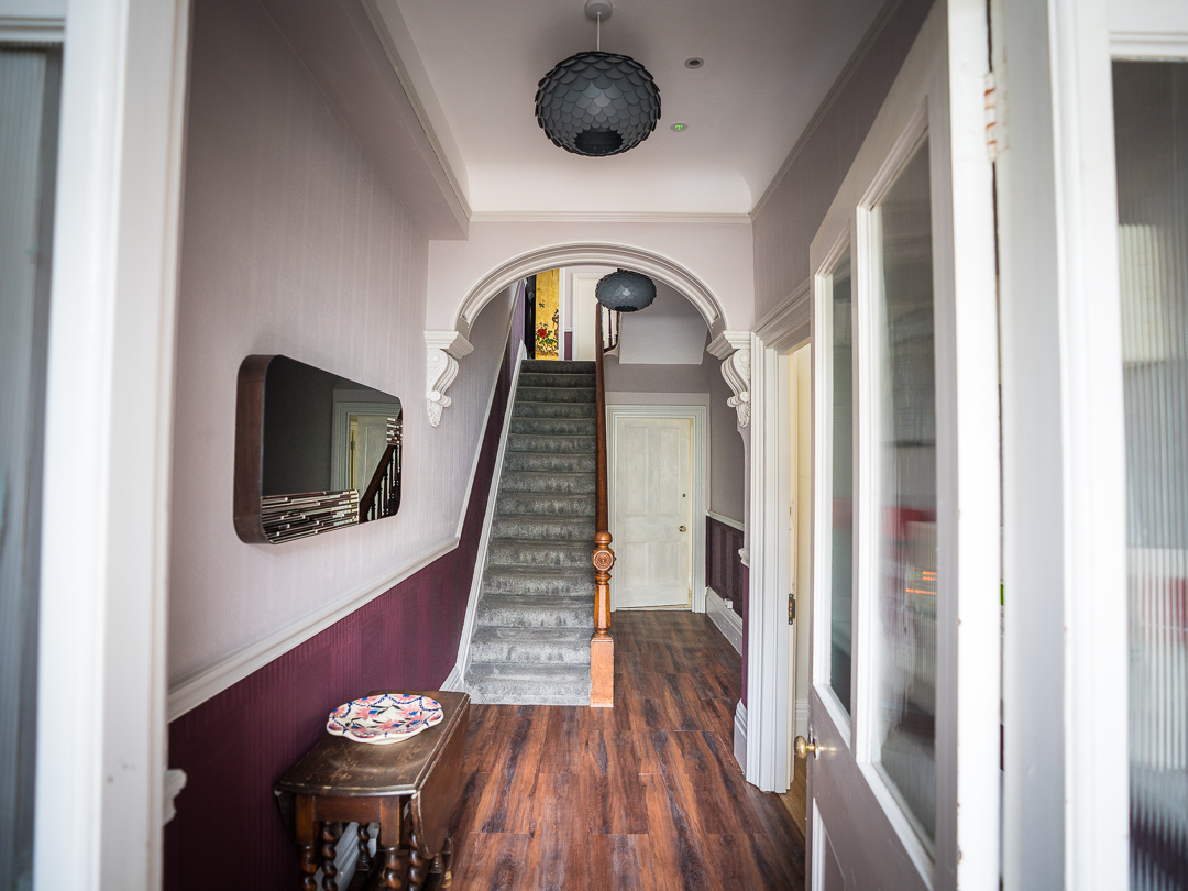 Shared entrance and internal staircase to self contained apartment