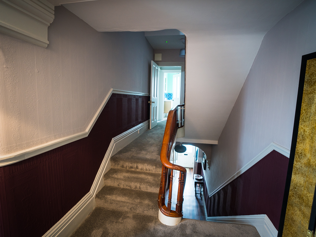Shared staircase leading to self contained apartment