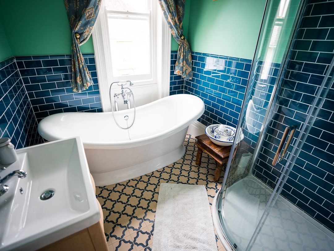 Bathroom with roll top bath, separate large shower and basin