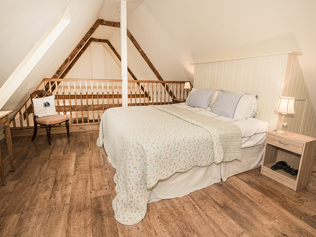 Open plan gallery with large double bed