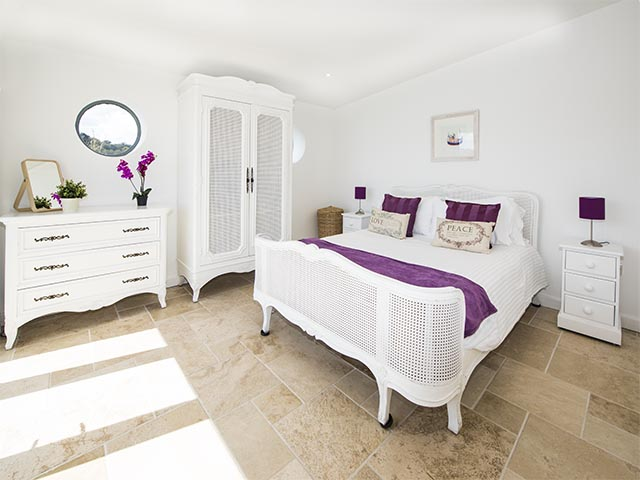 Bedroom one with King-size bed and sea view with access to terrace