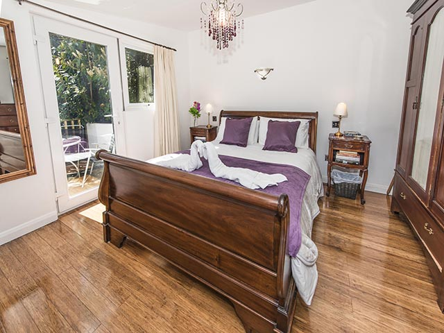 Bright and sunny bedroom with door to decked balcony