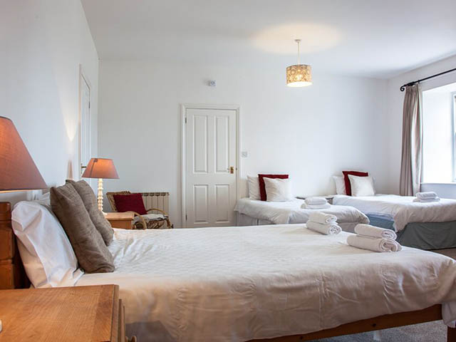 Large bedroom with double bed and 2 single beds