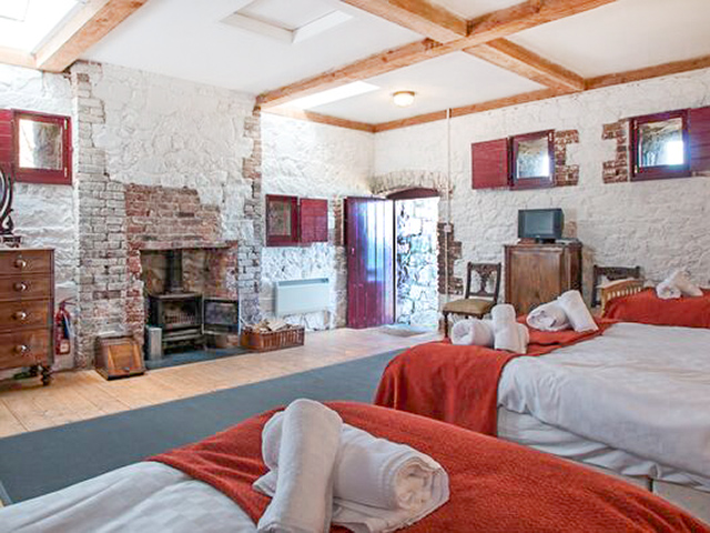 The large bedroom on the first floor has a double bed and 2 singles