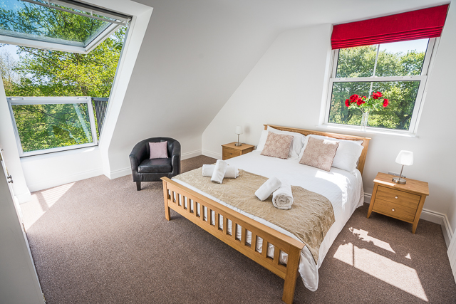Double bedroom located upstairs with Velux balcony and ensuite