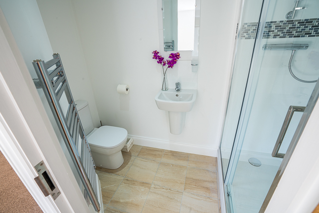 En-suite with large shower, sink and toilet
