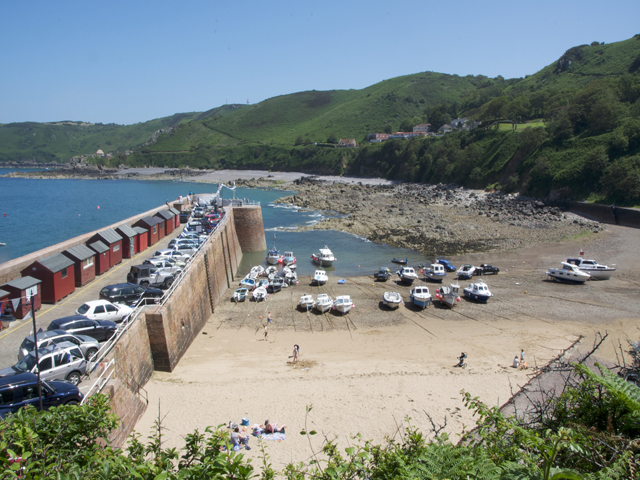 Bonne Nuit Bay has a small sandy beach beside the harbour