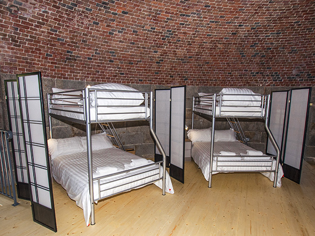 Bed pods, double bed with a single above, pods separated by screens