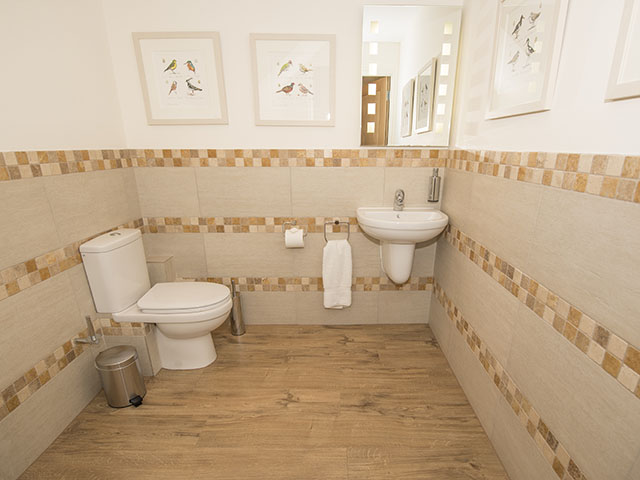 There is a spacious cloakroom on the ground floor