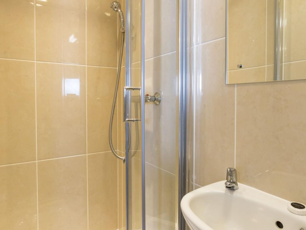 Ensuite shower room with shower, basin and toilet
