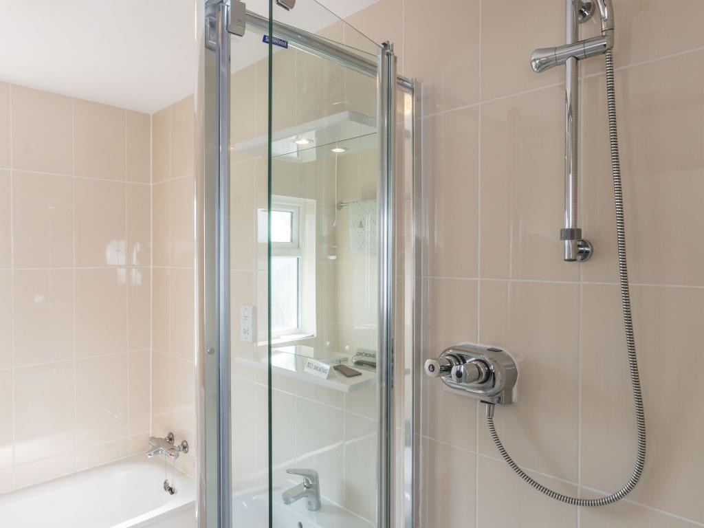 Bathroom with bath, separate shower, basin and toilet
