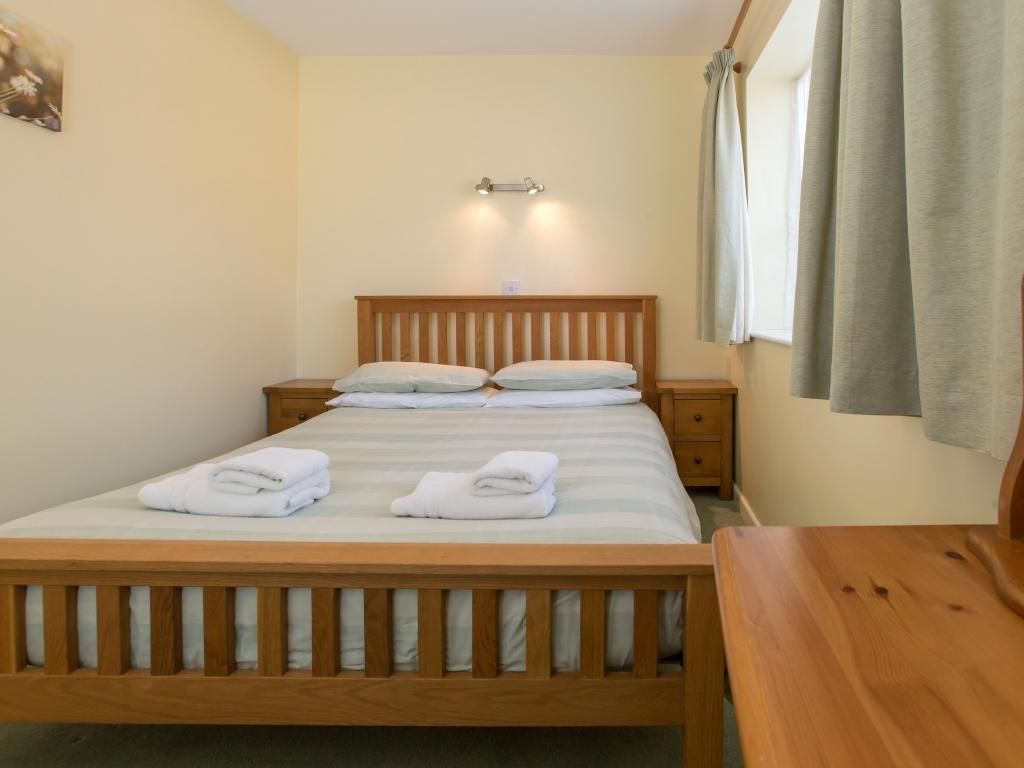 Double bedroom with double bed, this room is accessed by the twin bedroom