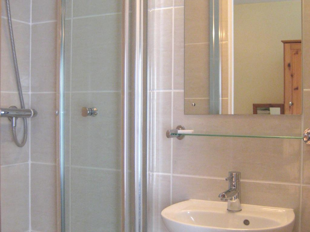 House bathroom with bath, separate shower, basin and toilet.