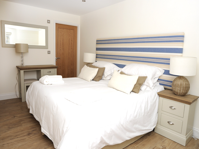 All cottages have a large double bedroom on the ground floor with an ensuite bathroom