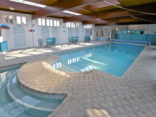 View of heated indoor pool at Beausite Apartments