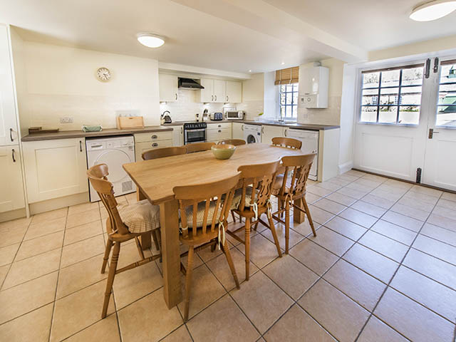 Spacious and well equipped kitchen with dining area