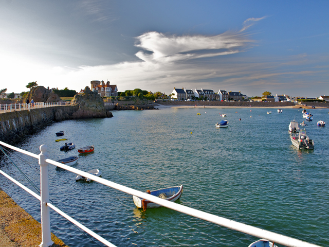 The pretty harbour at La Rocque is just a short drive or a bus ride away