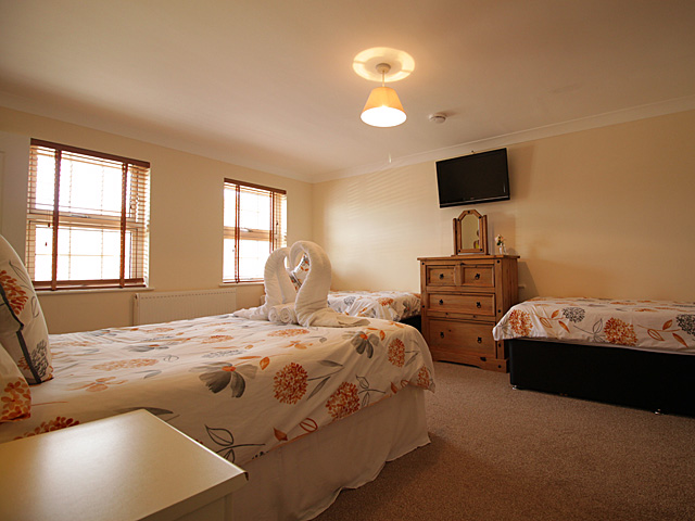 Spacious family room with double bed and 2 single beds