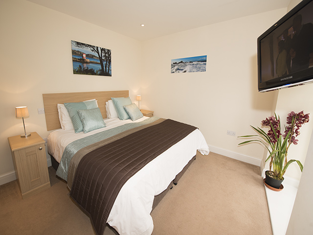 Master bedroom with a double bed which can be made up as 2 single beds