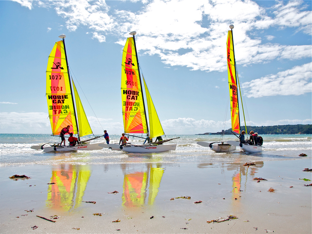Hobie Cats on the beach at St Aubin on the south coast