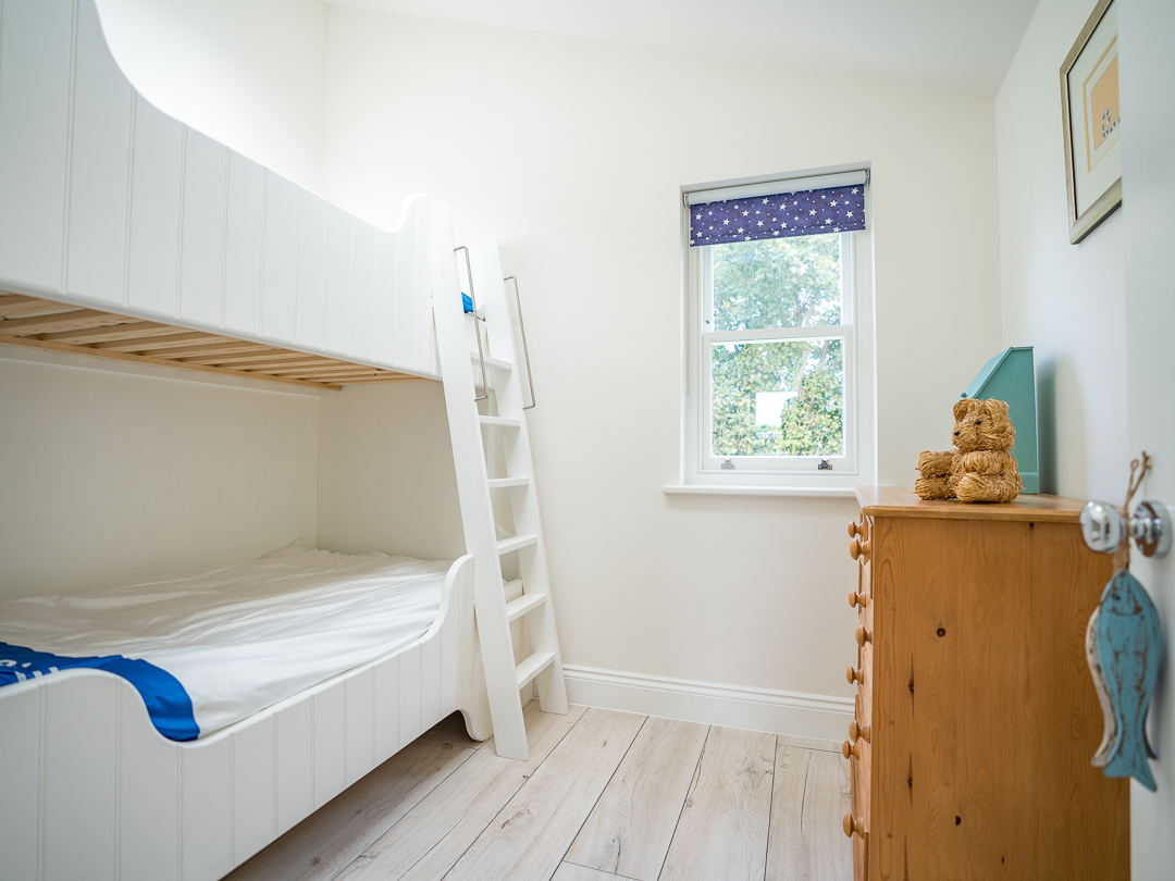 Second bedroom with large single bed plus single bunk bed above