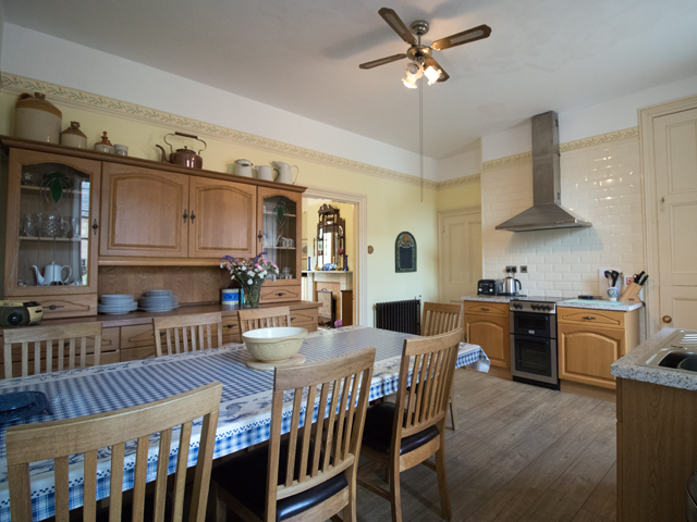 Spacious kitchen with large dining table
