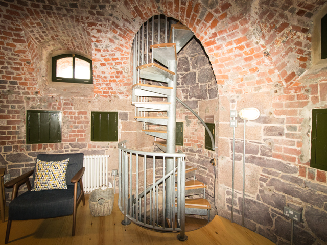 Narrow spiral staircase runs throughout 4 floors