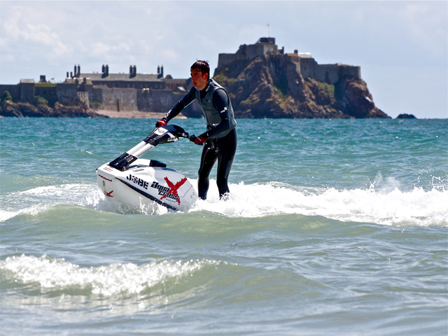 Jet skier on the water in St Aubin's bay