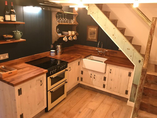Fully equipped kitchen with stairs to 1st floor
