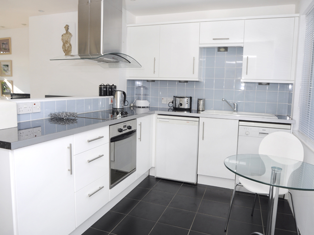 Kitchen area in St Ouen's Bay Apartment