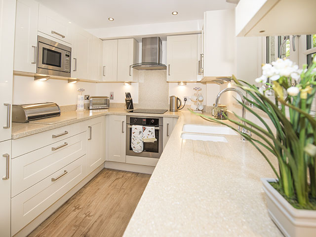 Well equipped and spacious kitchen area of open plan living room