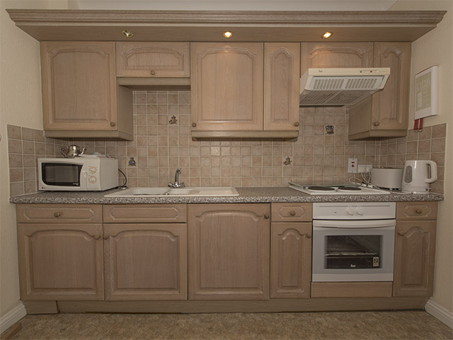 Style of kitchen area in one bedroom apartment