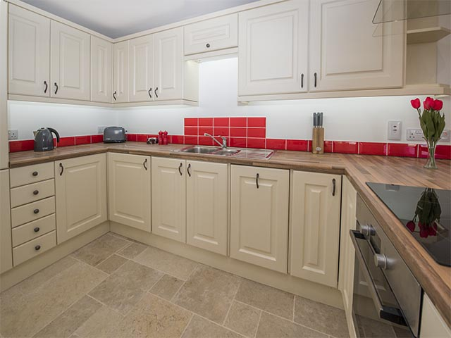Fully equipped kitchen in open plan room