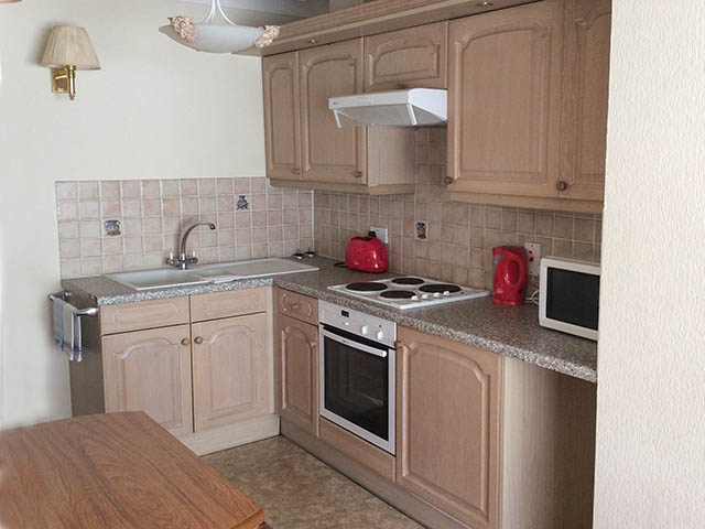 Fully equipped kitchen in open-plan room