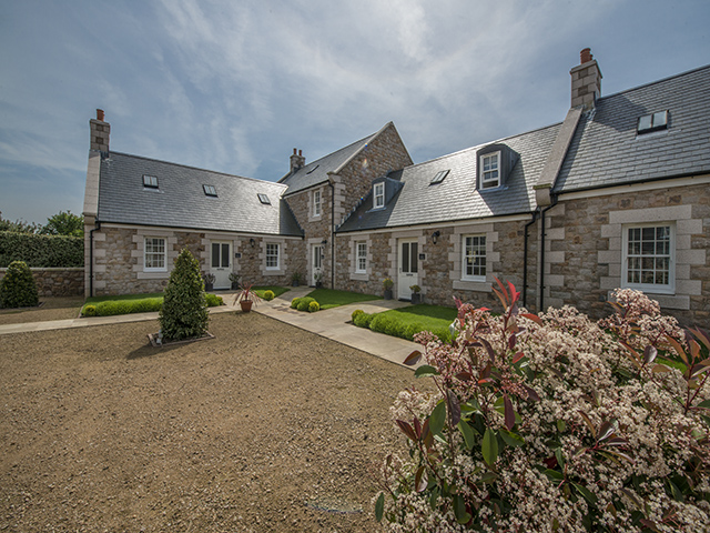 The 4 bedroom La Place Holiday Cottages occupy the corner plot of the pretty courtyard