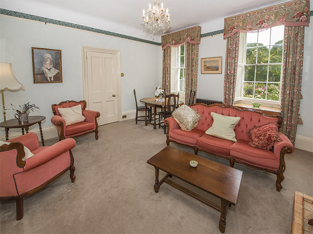 Formal dining room with sofas