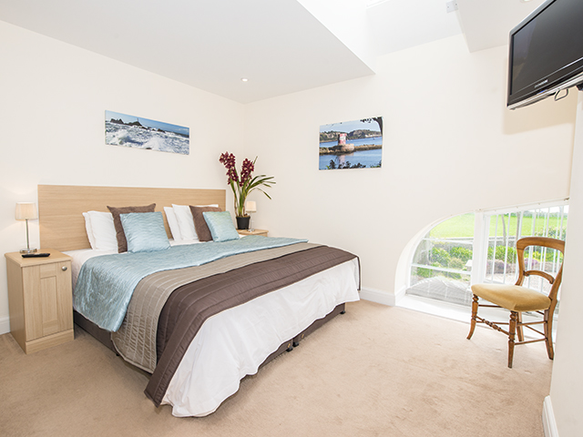 View of master bedroom with king size double bed which can also be made up as 2 singles