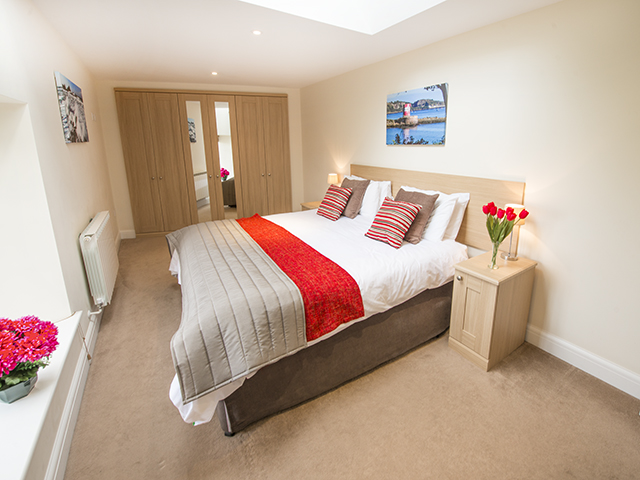 This large bedroom can accommodate another  2 single beds and can be made up as 4 singles or a double and 2 singles