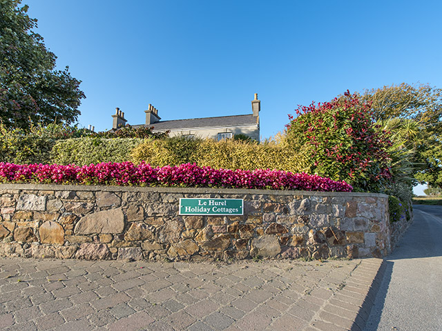 Entrance to Le Hurel Holiday Cottages from Trinity main road (La Route de la Trinite)