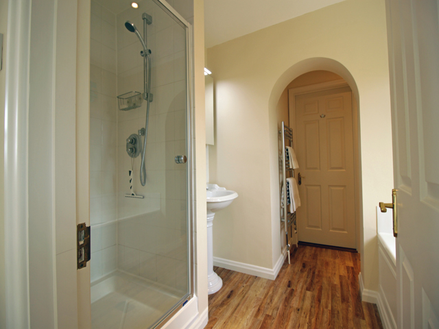 Bathroom with large shower cubicle and separate bath, basin and WC