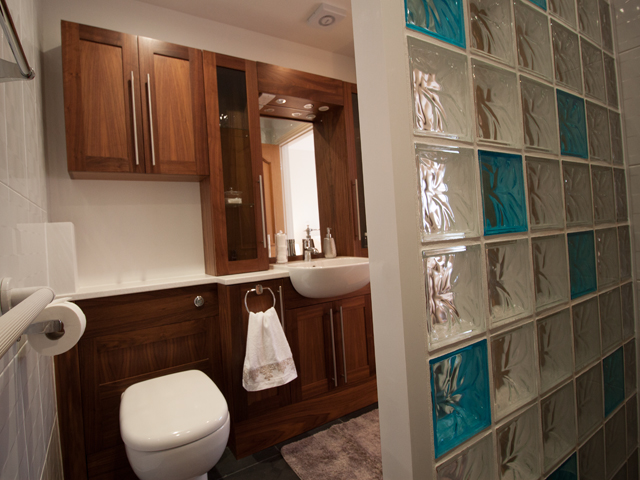 En-suite with wet room style shower, basin and toilet