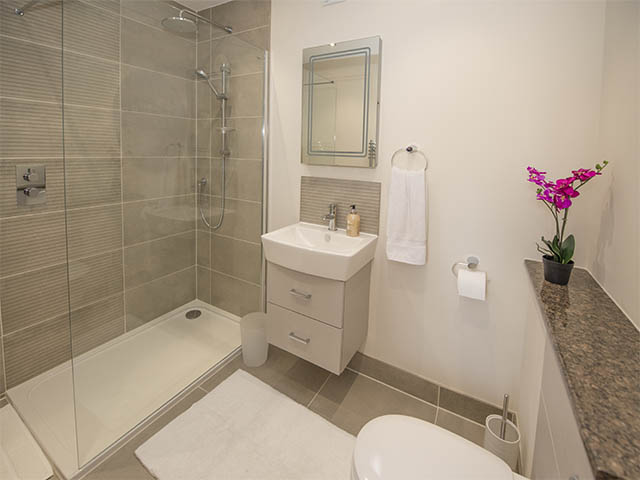 Spacious shower room with walk in shower