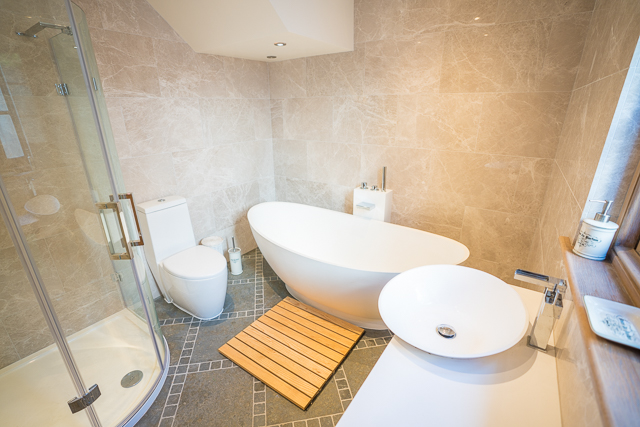 House bathroom with bath, shower, sink and toilet